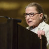 Ruth Bader Ginsburg speaking at a podium