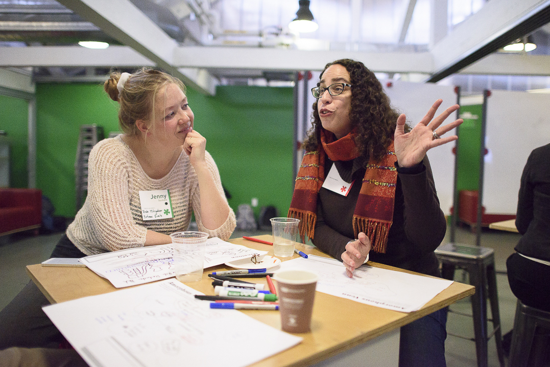 Jenny Suckale and Amalia Kessler in conversation at a desk during a Catalyst workshop at the d.school