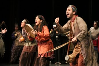 Actors on stage performing traditional Iranian play Tarabnameh
