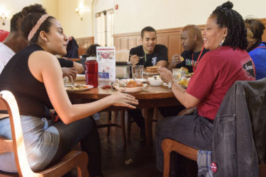 family members in conversation at dining hall