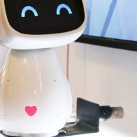 A cute robot with a heart on its belly.