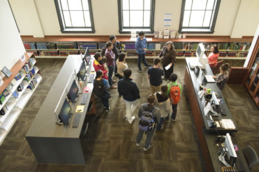 Librarian leads students on an orientation of the Li & Ma Science Library