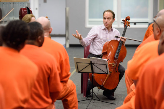 Stanford Artist-In-Residence, cellist Christopher Costanza, of the St. Lawrence String Quartet, speaks to a group of inmates at the San Francisco county jail.
