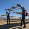 Workers cleaning solar panels