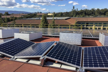 Photovoltaic panels on the roof of Maples Pavilion ready for installation