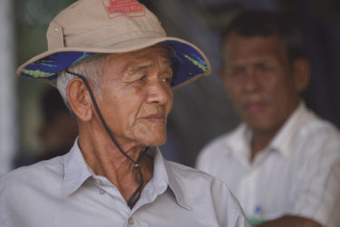 headshot of an elderly Cambodian man