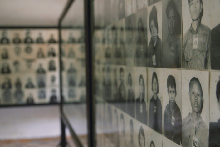walls of photos of genocide victims)