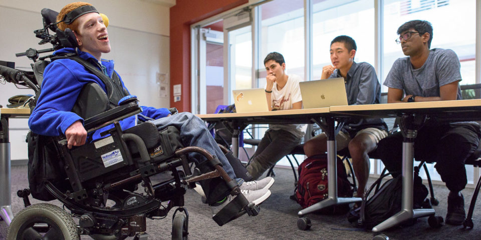 Zach Crighton, a 17-year-old high school student with cerebral palsy, meets with the Compassionate Design class taught by John Moalli. The students are hoping they can make improvements to his wheelchair and communications tools. Zach was brought down from Washington state to answer students questions about his devices.
