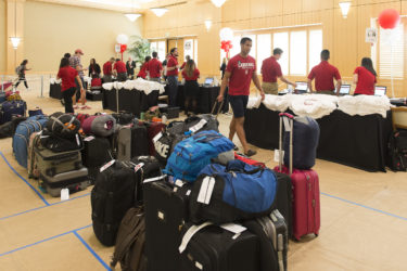 Admits check in at Arrillaga Alumni Center; their luggage is sorted into dorm destination groups.
