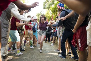 Admit runs gantlet of cheering student volunteers
