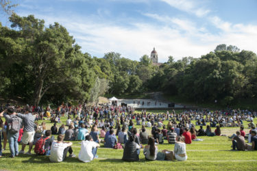 admits sitting on the grass in Frost Amphitheater