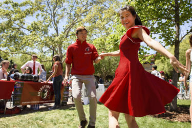 students dance the Lindy Hop at Admit Weekend activities fair