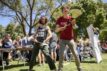 Isaac Caswell and Matt Mistele demonstrate hurling at the Activities Fair