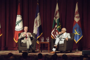 President Marc Tessier-Lavigne and Vice President Harry Elam onstage at Memorial Auditorium