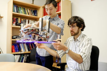 Hao Jiang, graduate student in the Cutkosky lab and lead author of the paper and Elliot Hawkes, MS '11, PhD '15, a visiting assistant professor from the University of California, Santa Barbara and co-author of the paper, hold the custom robotic gripper.
