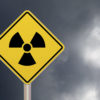 radioactive sign against a cloudy sky