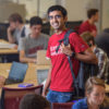 Graduate student Chiraag Sumanth stands among fellow students in the Huang Engineering Center.