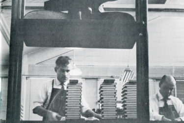 A 1959 photo shows Stanford University Press' workers next to a pressurizer.