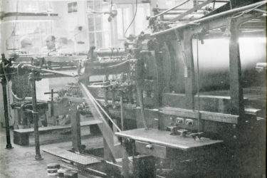 A 1959 photo shows a letterpress inside the facilities of Stanford University Press.