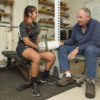 Senior research scientist Dennis Grahn meets with student research assistant Riasoya Jodah, a Women's Rugby team member. Jodah has been working with Heller and Grahn to test the effects of the cooling glove on strength conditioning training.