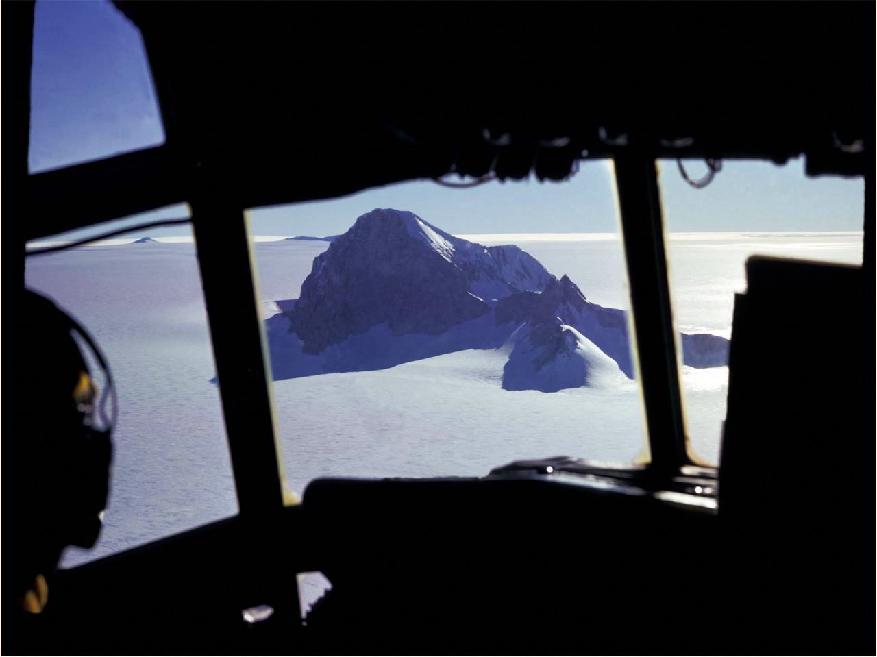 View of Whitmore Mountain in central West Antarctica from the C-130 flight deck. Mountain peaks provided valuable fixed points for navigation as well as regions for scientific investigation.