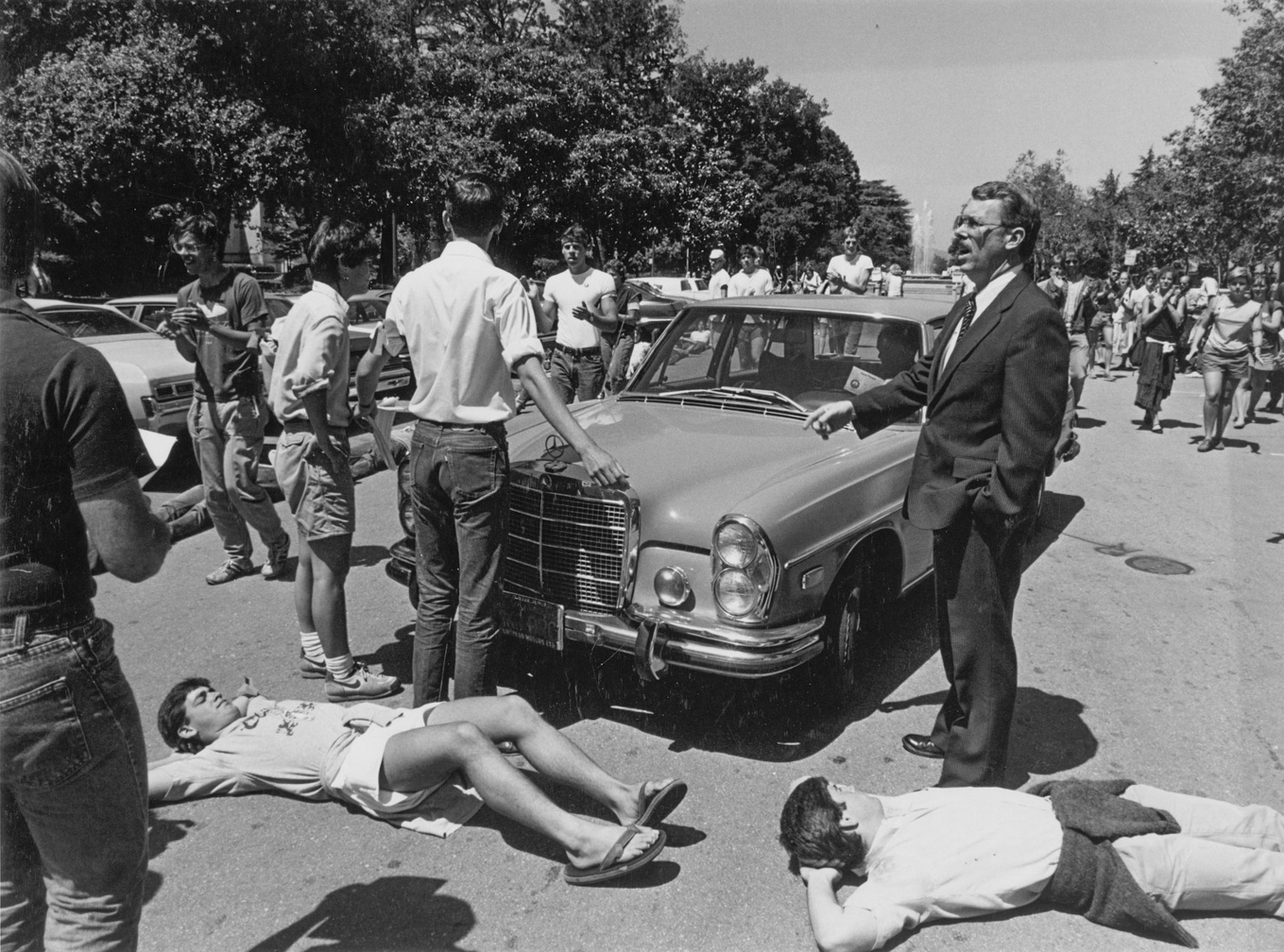 April 1985: Students protesting university investments in South Africa block trustees' cars. At right is police chief Marvin Herrington.