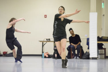 Graduate students Colette Kelly and Glory Liu perform a movement combination.