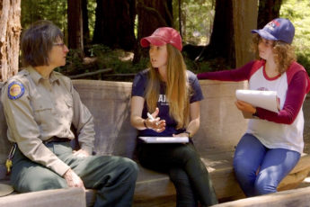 Video still of students talking with a park ranger as part of a community-engaged learning program