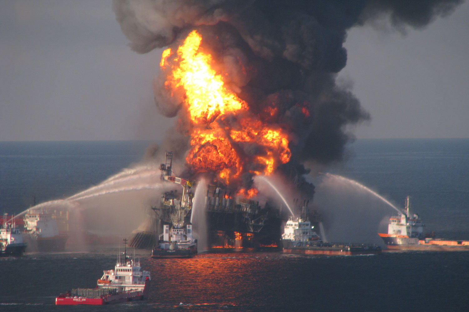 Fire boats and rescue crews respond to the 2010 Deepwater Horizon oil platform disaster in the Gulf of Mexico, the largest marine oil spill in history.