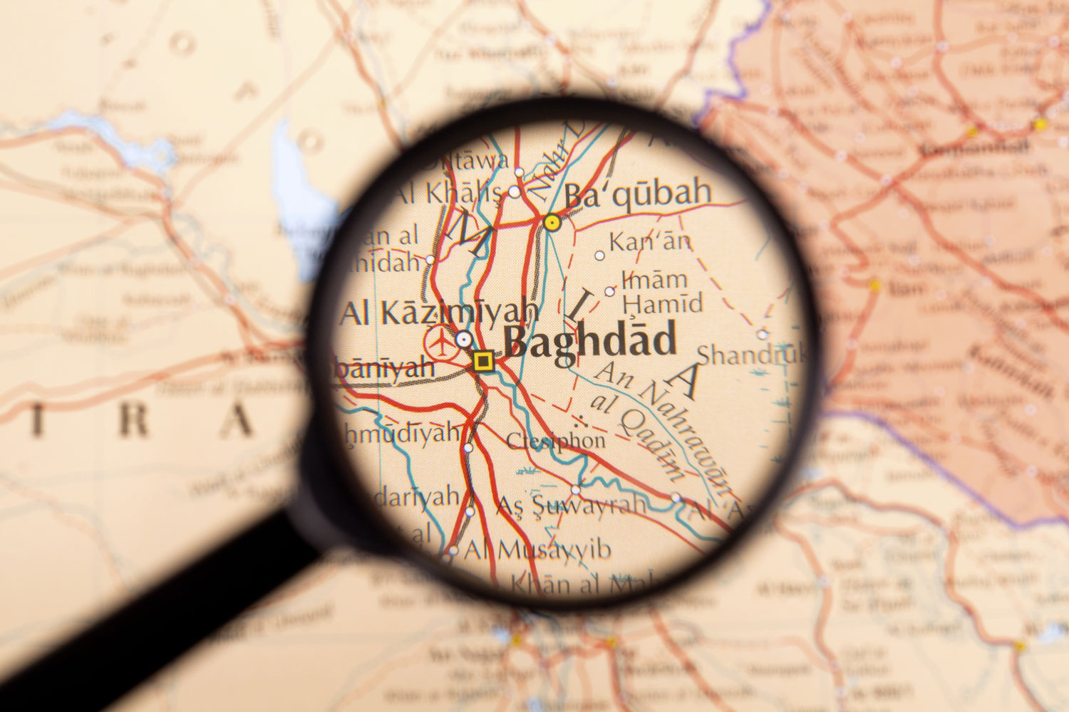 map of Iran with magnifying glass focused on Baghdad