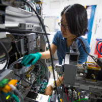 Fang Ren, who developed algorithms to analyze data on the fly while a postdoctoral scholar at SLAC, at a Stanford Synchrotron Radiation Lightsource beamline where the system has been put to use.