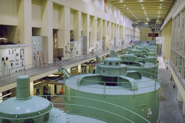 A series of large generators inside a dam)