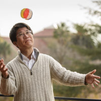 Takashi Tokieda bats about a kamifusen, or Japanese paper balloon, to inflate it