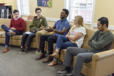 Five students speak as part of a multifaith panel