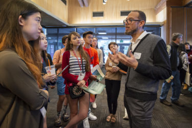 Professor Vaughn Rasberry talks with admitted students.