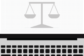 The scales of justice on a laptop screen.