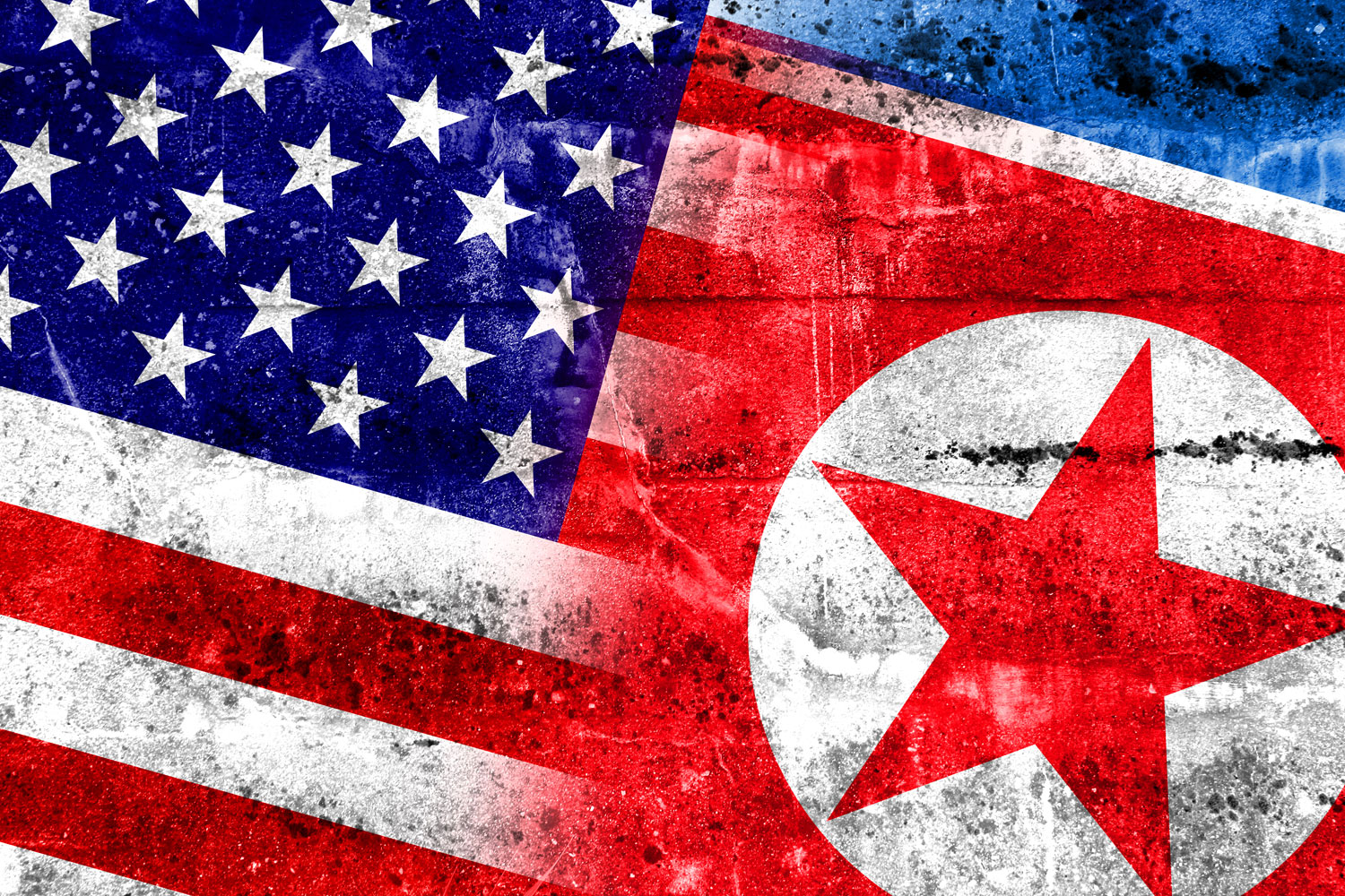 U.S. and North Korea flags painted on a grungy concete wall