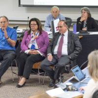 Robert Weisberg, Yvonne Maldonado and Matt Snipp at the faculty senate