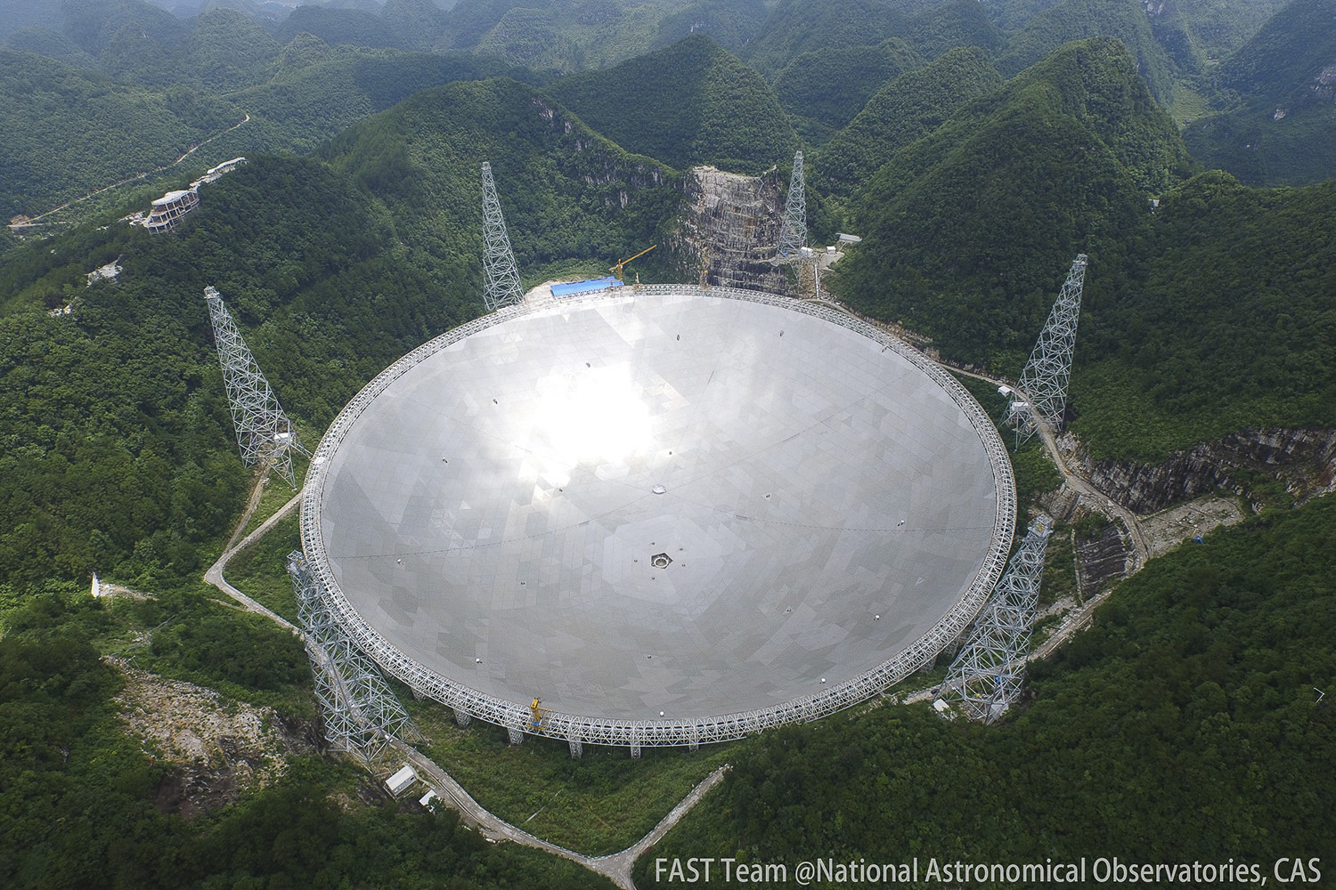 China's 500-meter Aperture Spherical Telescope (FAST). A Stanford-led international collaboration discovered an extremely faint millisecond pulsar. (Image credit: Courtesy FAST Team @ National Astronomical Observatories, CAS)