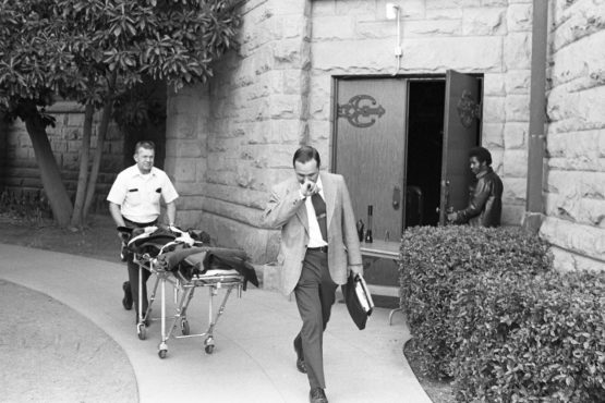 The body of Arlis Perry is wheeled to a vehicle by Santa Clara County officials. 10-13-1974