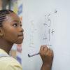Girl solving math problem