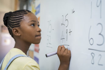 Girl solving math problem