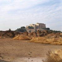 Saddam Hussein's Palace in Hillah, Iraq seen on the hill from within the ancient Babylon.