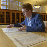 Rowan W. Dorin, assistant professor of history, with the palimpsest document.