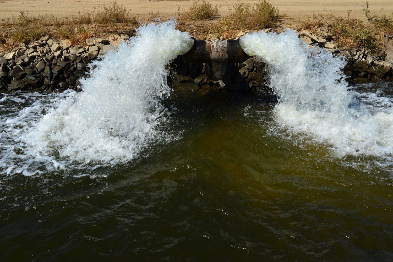 water pumping into irrigation ditch