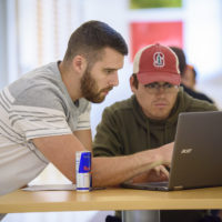 Garrett Gross, left, and Hugo Santos Parada, discuss an assignment