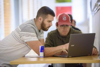 Garrett Gross, left, and Hugo Santos Parada, discuss an assignment