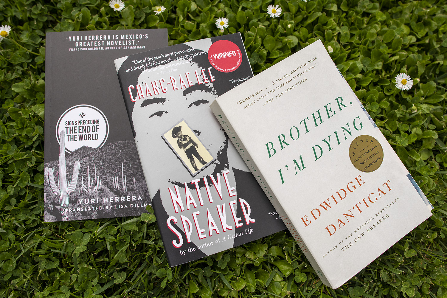 The Three Books of the 2018 summer reading program for incoming students.