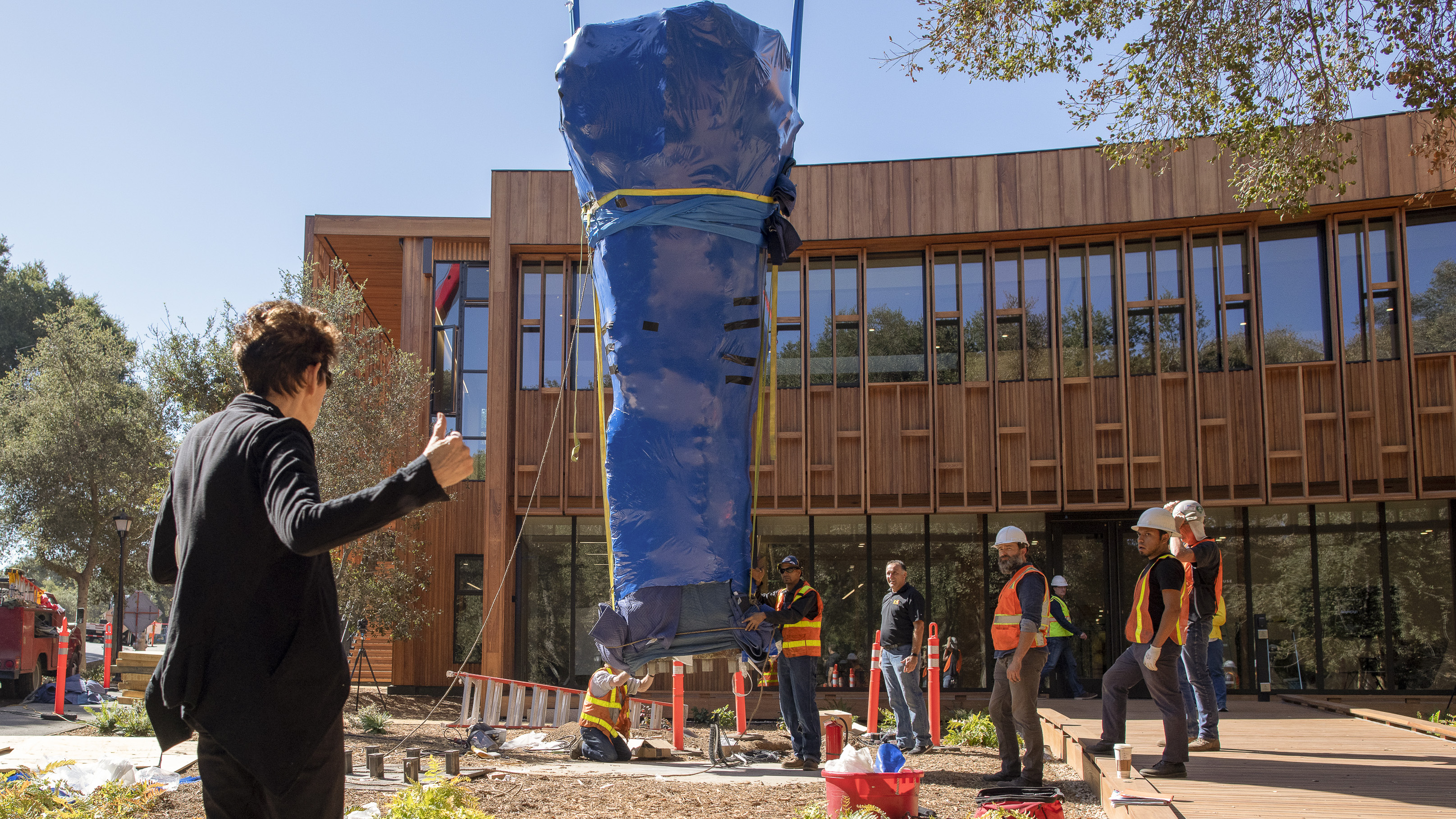 The installation of the bronze sculpture at Denning House