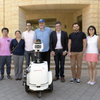 JackRabbot project team with their robot